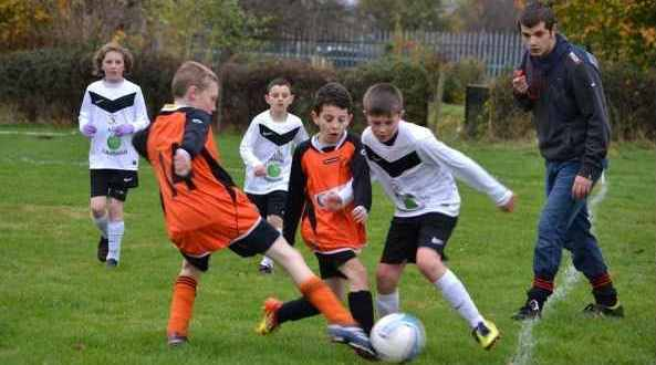 Overthorpe Under 11s in action against Howden Clough - they lost 19-0